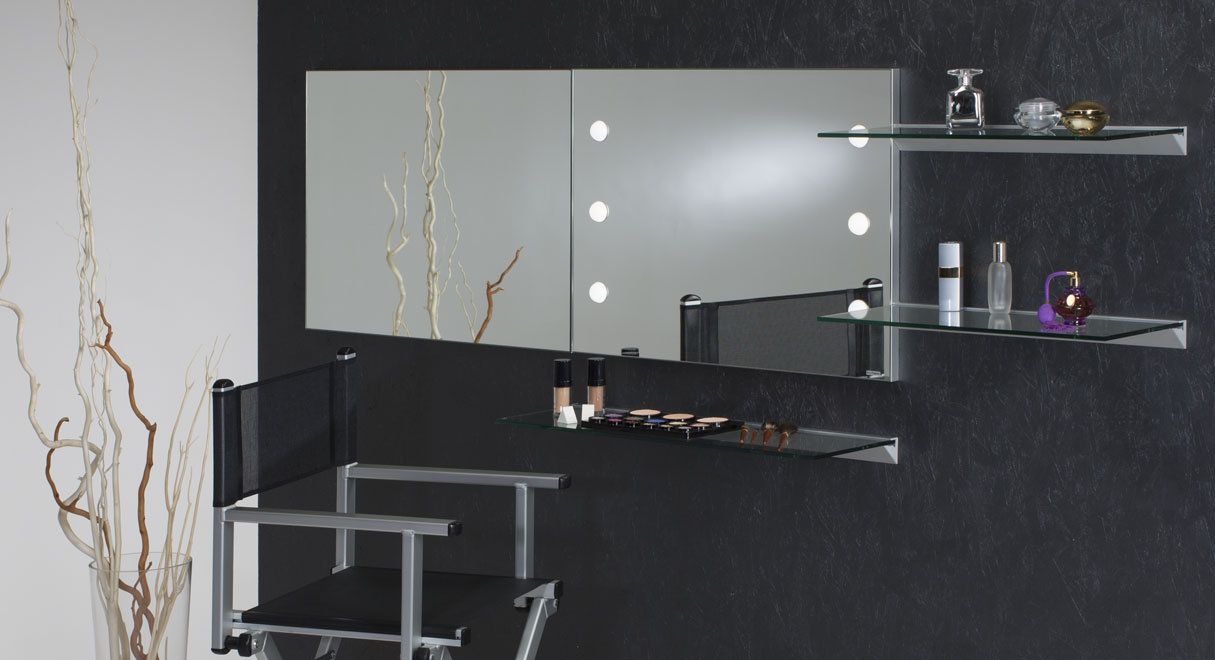 Makeup mirrors mounted on wall